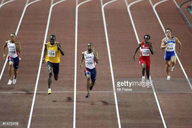 Track & Field: 11th IAAF World Championships, USA Tyson Gay in action, crossing finish line and winning 200M Final vs Jamaica Usain Bolt , and USA...
