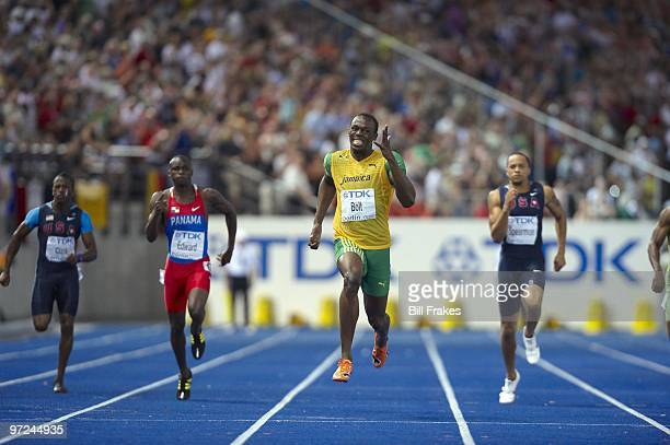 12th IAAF World Championships: Jamaica Usain Bolt in action, winning Men's 200M Final gold medal with world record time of 19.19 at Olympiastadion....
