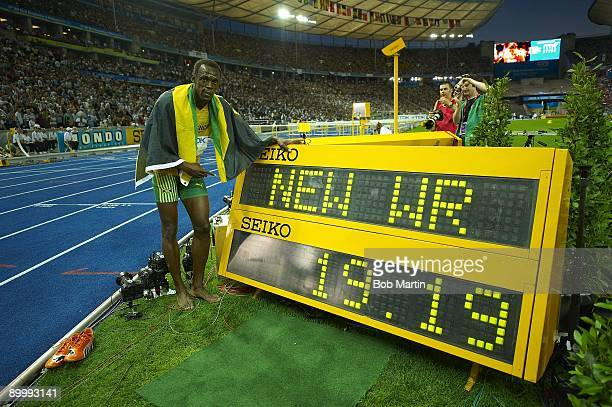 12th IAAF World Championships: Jamaica Usain Bolt victorious with world record sign after winning Men's 200M Final gold medal with time of 19.19 at...
