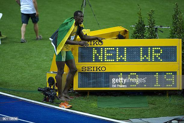 12th IAAF World Championships Jamaica Usain Bolt victorious with world record sign after winning Men's 200M Final gold medal with time of 1919 at...