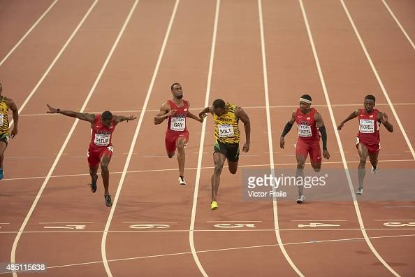 Jamaica Usain Bolt in action, crossing finish line to win ...