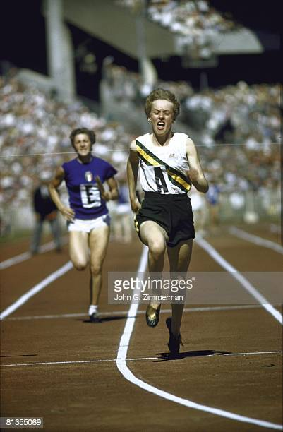 Track Field 1956 Summer Olympics AUS Betty Cuthbert in action winning 4X100M relay race Melbourne AUS 12/8/1956