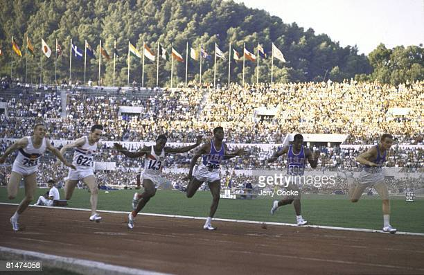 Track Field 1960 Summer Olympics DEU Armin Hary in action winning 100M finals race vs USA David Sime and GBR Peter Radford Rome ITA 8/25/19609/11/1960