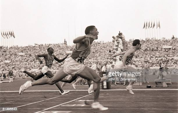 Track Field 1960 Summer Olympics ITA Livio Berruti in action winning 200M final race vs USA Les Carney Rome ITA 8/25/19609/11/1960
