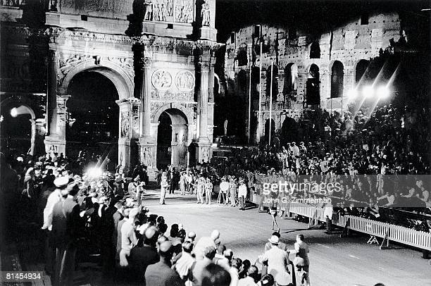 Track Field 1960 Summer Olympics Scenic view of ETH Abebe Bikila in barefoot action breaking world record and winning marathon at Arch of Constantine...