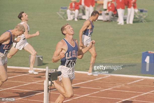 Track Field 1960 Summer Olympics USA Glenn Davis in action and winning 400M hurdles race at finish line Rome ITA 8/25/19609/11/1960