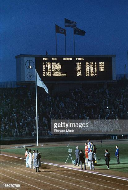 1964 Summer Olympics Overall view of USA Billy Mills Australia Ron Clarke and Tunisia Mohamed Gamoudi on medal stand after Men's 10000M Final at...