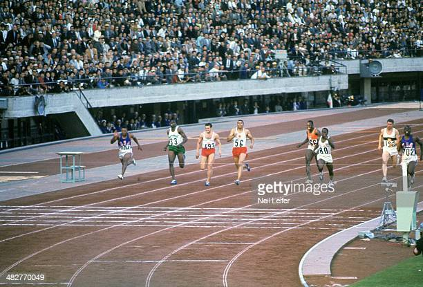 1964 Summer Olympics USA Bob Hayes Cuba Enrique Figuerola and Canada Harry Jerome in action during Men's 100M Finals at National Olympic Stadium...