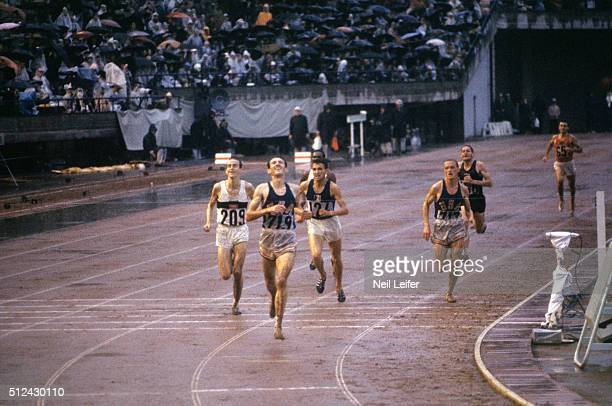 1964 Summer Olympics USA Bob Schul victorious at finish line winning Men's 5000M Final gold at National Olympic Stadium West Germany Harald Norpoth...
