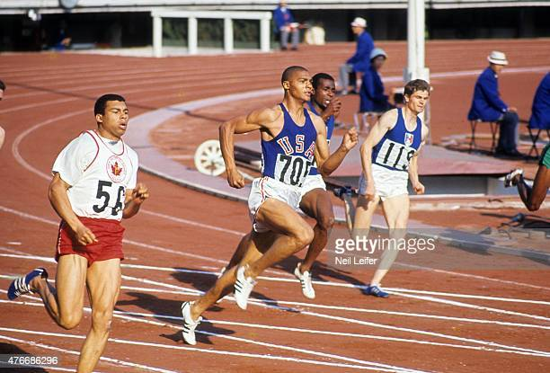 1964 Summer Olympics USA Henry Carr and Canada Harry Jerome in action during Men's 200M Final at National Olympic Stadium Carr wins gold Tokyo Japan...