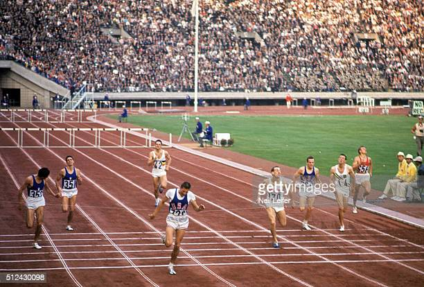 1964 Summer Olympics USA Rex Cawley in action crossing finish line to win Men's 400M Hurdles Final at National Olympic Stadium Tokyo Japan CREDIT...