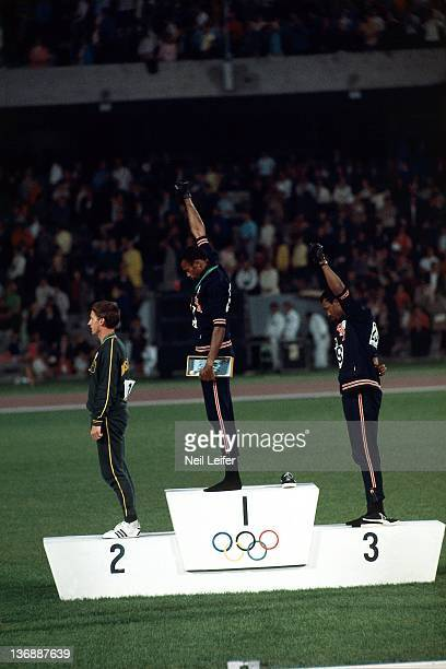 Track Field 1968 Summer Olympics Australia Peter Norman USA Tommie Smith and USA John Carlos on medal stand during Men's 200M medal presentation at...