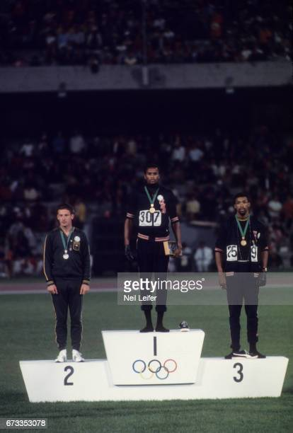 Summer Olympics: Australia Peter Norman , USA Tommie Smith , and USA John Carlos on medal stand during Men's 200M medal presentation at Estadio...