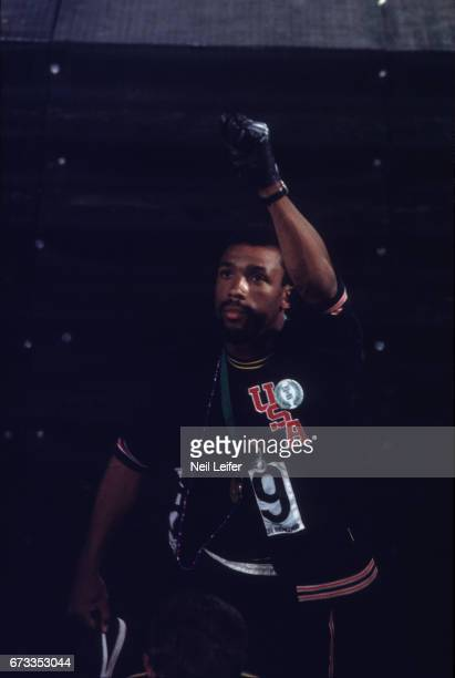 1968 Summer Olympics Close up of USA John Carlos with fist raised after medal stand presentation for the Men's 200M at Estadio Olimpico Tommie Smith...