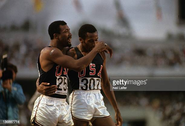 Track & Field: 1968 Summer Olympics: Closeup of USA John Carlos and Tommie Smith victorious after winning Men's 200M Final at the Estadio Olimpico....