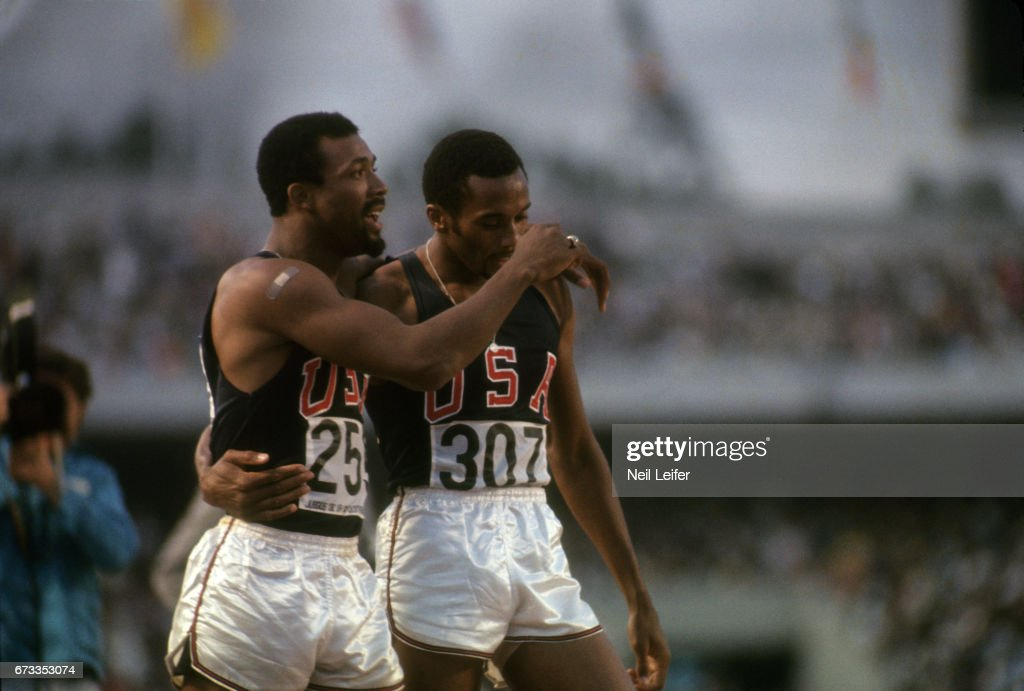USA John Carlos (259) and USA Tommie Smith (307) after Men's 200M Final at Estadio Olimpico. Smith (gold) and Carlos (bronze) wore black gloves and raised fists for racial equality in USA. Black Power salute. Neil Leifer X13565 TK8 R71 F19 )
