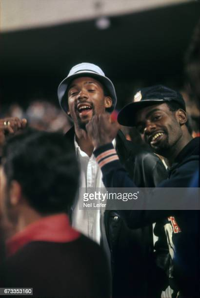 Summer Olympics: USA John Carlos with light blue hat and raised fist after medal stand for Men's 200M medal presentation at Estadio Olimpico. Tommie...