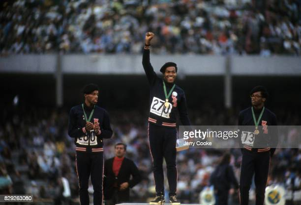 Summer Olympics: USA Lee Evans victorious with gold medal on stand after winning Men's 400M Final at Estadio Olimpico. Mexico City, Mexico -- CREDIT:...