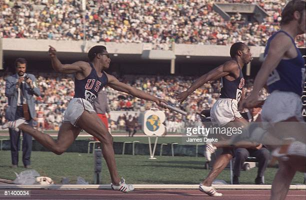 Track Field 1968 Summer Olympics USA Ronnie Ray Smith in action handing baton to teammate Jim Hines during 4X100M relay race Mexico City MEX