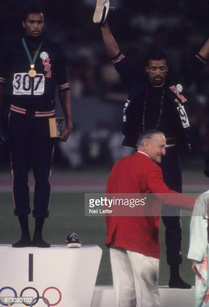 Summer Olympics: USA Tommie Smith and John Carlos getting bronze medal for the Men's 200M during medal presentation at Estadio Olimpico. Tommie Smith...