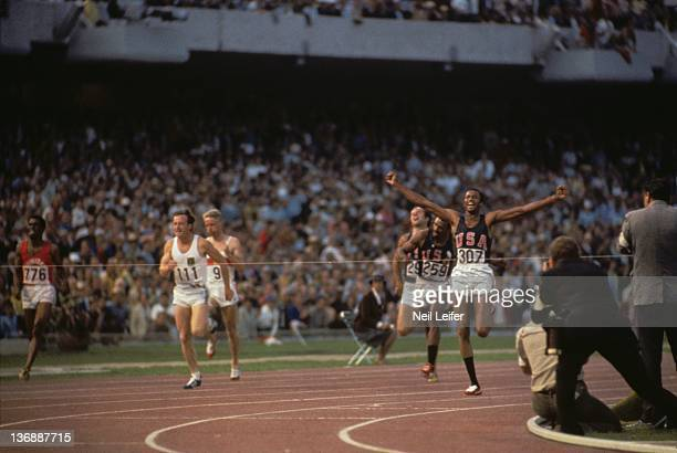 Track & Field: 1968 Summer Olympics: USA Tommie Smith victorious as he finishes Men's 200M race at the Estadio Olimpico. Mexico City, Mexico CREDIT:...