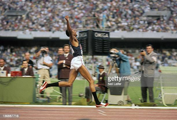 Track Field 1968 Summer Olympics USA Tommie Smith victorious as he finishes Men's 200M race at the Estadio Olimpico Mexico City Mexico CREDIT Neil...