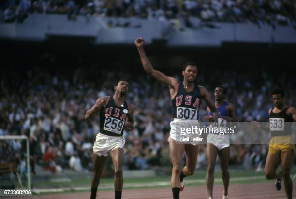 1968 Summer Olympics USA Tommie Smith victorious with arm raised and John Carlos after winning Men's 200M Final at Estadio Olimpico Mexico City...