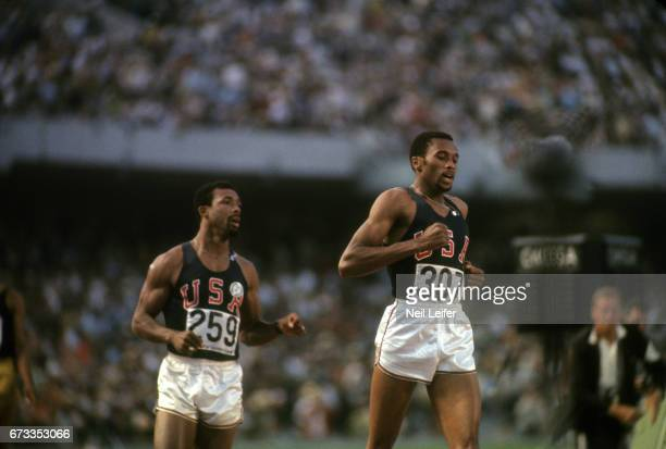 1968 Summer Olympics USA Tommie Smith with John Carlos victorious after winning Men's 200M Final at Estadio Olimpico Mexico City Mexico CREDIT Neil...