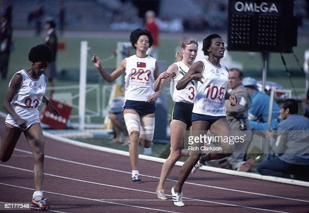 1968 Summer Olympics USA Wyomia Tyus in action winning 100M Finals vs USA Barbara Ferrell and Poland Irena Szewinska at Estadio Olimpico Mexico City...