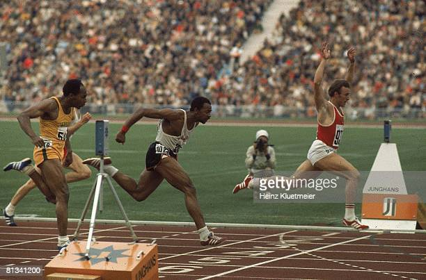Track Field 1972 Summer Olympics Soviet Union Valery Borzov in action crossing finish line and winning 100M race vs USA Robert Taylor and Jamaica...
