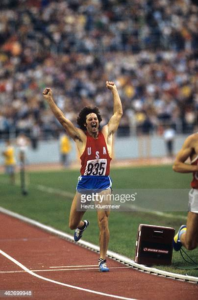 1976 Summer Olympics USA Bruce Jenner in action and victorious while crossing finish line during 1500M of Decathlon at Olympic Stadium Montreal...