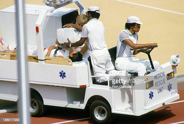 1984 Summer Olympics Switzerland Gabriela AndersenScheiss with medical personnel attending to her in cart after finishing women's marathon at Los...