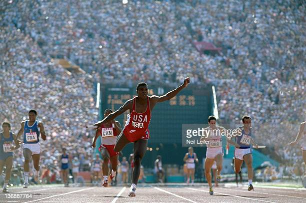 Track Field 1984 Summer Olympics USA Carl Lewis in action leading race and setting world record after taking baton from teammate Calvin Smith during...