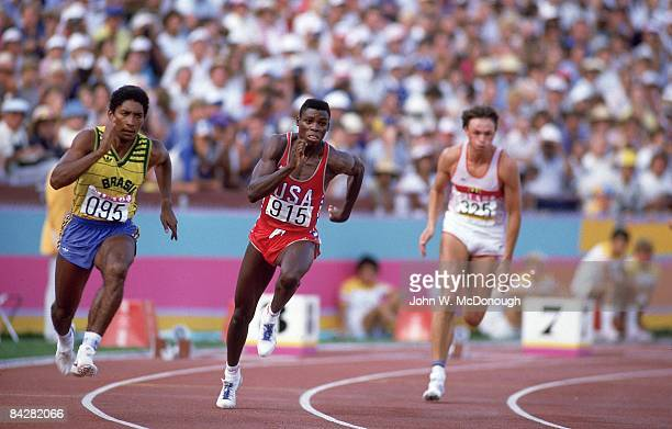 1984 Summer Olympics USA Carl Lewis in action leading race vs Brazil Joao Batista da Silva and West Germany Ralf Lubke during Men's 200M Semifinals...