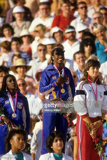 1984 Summer Olympics USA Valerie BriscoHooks victorious on medal stand after winning gold in Women's 400M Final race USA Chandra Cheeseborough wins...