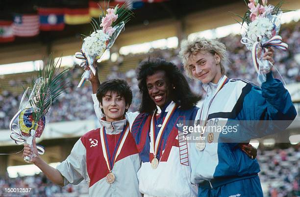 1988 Summer Olympics USA Evelyn Ashford USA Florence Griffith Joyner and East Germany Heike Drechsler victorious with medals after Women's 100M Final...