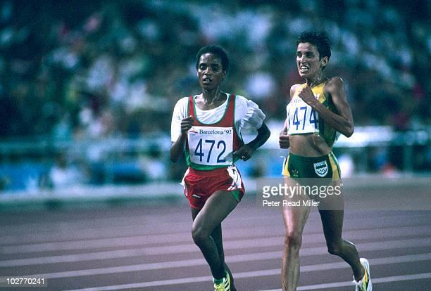 1992 Summer Olympics Ethiopia Derartu Tulu in action vs South Africa Elana Meyer during Women's 10000M Final at Estadi Olimpic de Montjuic Barcelona...