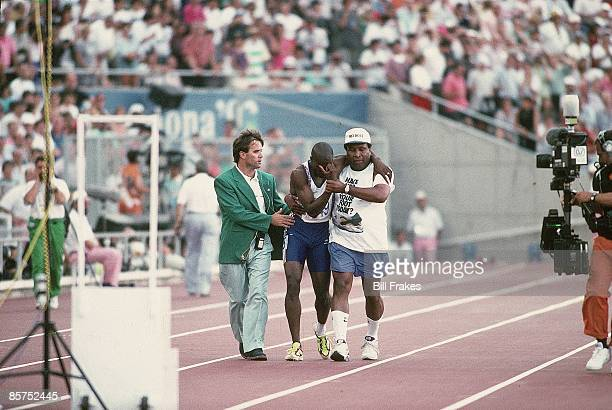 1992 Summer Olympics Great Britain Derek Redmond with father after hamstring injury during Men's 400M Semifinal Heat 1 at Estadi Olimpic de Montjuic...