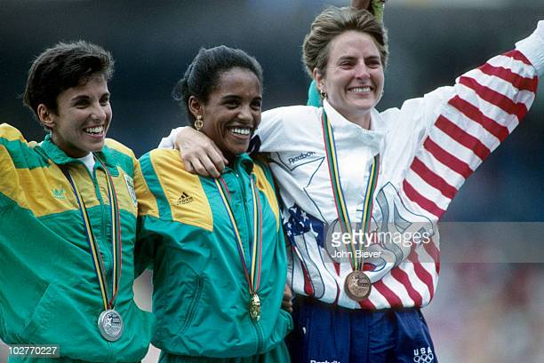 1992 Summer Olympics South Africa Elana Meyer Ethiopia Derartu Tulu and USA Lynn Jennings victorious after Women's 10000M Final at Estadi Olimpic de...