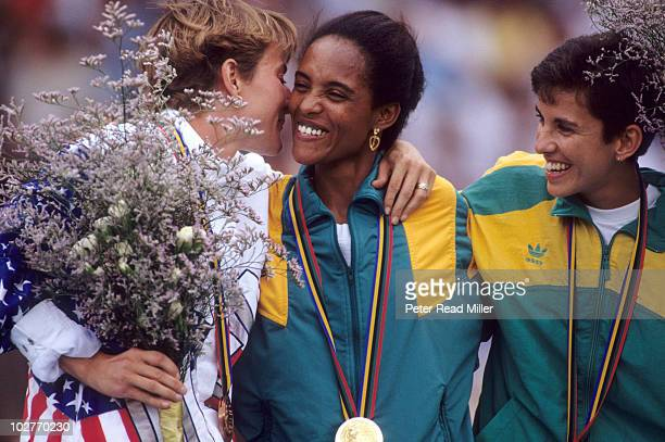 1992 Summer Olympics USA Lynn Jennings victorious kissing Ethiopia Derartu Tulu with South Africa Elana Meyer after Women's 10000M Final at Estadi...