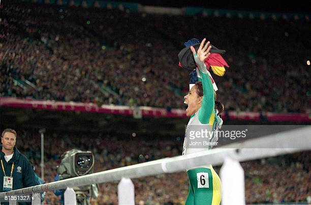 Track Field 2000 Summer Olympics Australia Cathy Freeman victorious waving to fans after winning 400M final at Olympic Stadium Sydney AUS 9/25/2000