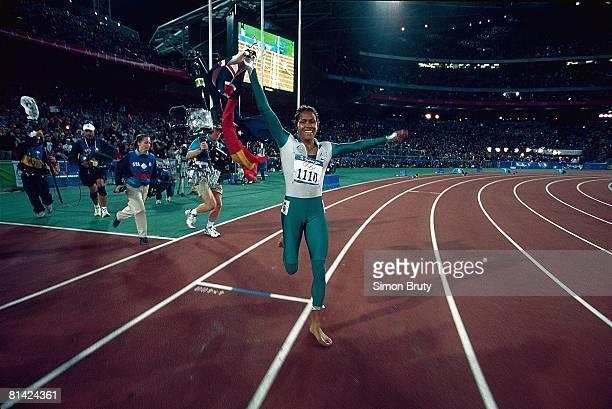 Track & Field: 2000 Summer Olympics, Australia Cathy Freeman victorious after winning 400M final at Olympic Stadium, Sydney, AUS 9/25/2000