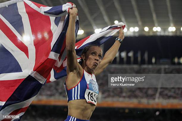 Summer Olympics: Closeup of Great Britain Kelly Holmes victorious with flag after winning gold during Women's 1500M Final at Olympic Stadium. Athens,...