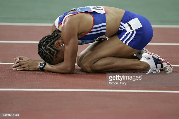 Summer Olympics: Closeup of Great Britain Kelly Holmes victorious after winning gold during Women's 1500M Final at Olympic Stadium. Athens, Greece...