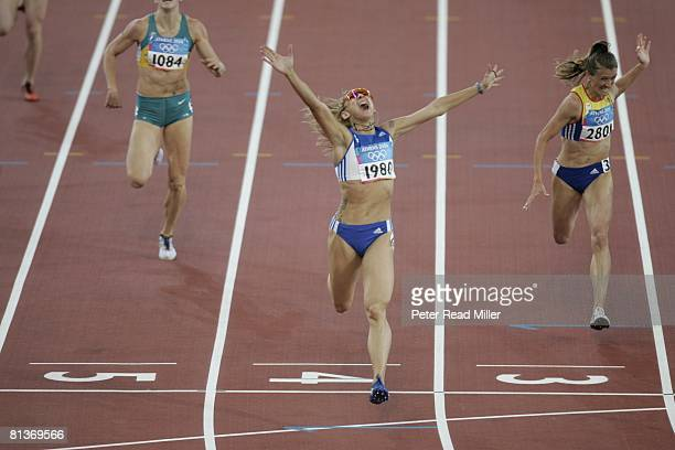 Track Field 2004 Summer Olympics GRC Fani Halkia victorious after 400M hurdles at Olympic Stadium Athens GRC 8/25/2004