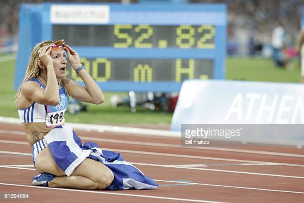 Track Field 2004 Summer Olympics GRC Fani Halkia victorious with flag after 400M hurdles at Olympic Stadium Athens GRC 8/25/2004