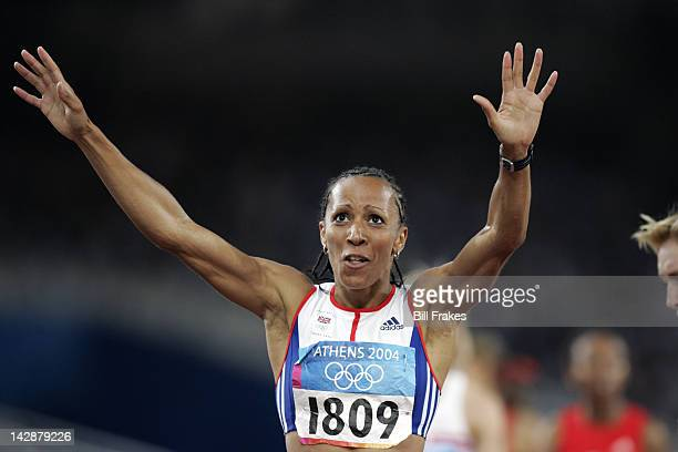 Summer Olympics: Great Britain Kelly Holmes victorious after winning gold during Women's 1500M Final at Olympic Stadium. Athens, Greece 8/28/2004...