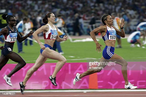 Summer Olympics: Great Britain Kelly Holmes and Russia Tatyana Andrianova in action during Women's 800M Semifinals at Olympic Stadium. Athens, Greece...