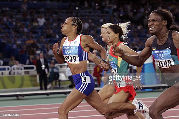 Summer Olympics: Great Britain Kelly Holmes , Morocco Hasna Benhassi , and Mozambique Maria Mutola in action during Women's 800M Final at Olympic...