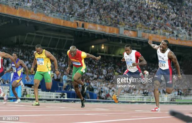 Track & Field: 2004 Summer Olympics, PRT Francis Obikwelu, USA Justin Gatlin, and USA Shawn Crawford in action during 100M final race at Olympic...